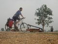 #9: Cyclist, Mobile Pump and Farmer