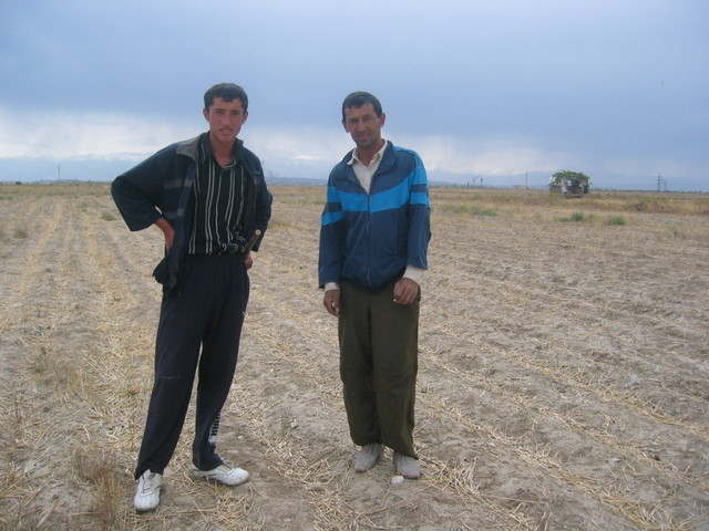 Two Farmers Working in the Fields