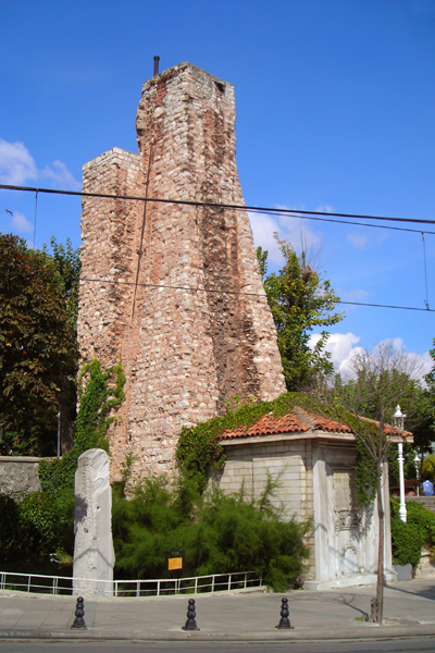 Ruins of triumphal arch Miliarium Aureum (The Golden Mile) and Turkish water-tower