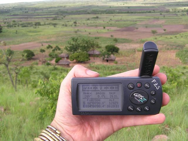 The trusty GPS with the coordinates and Mzee Matinde's house in the background.