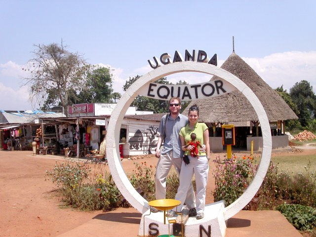 Laurel and Brian crossing the equator on the main road from Kampala (note funnel in foreground).