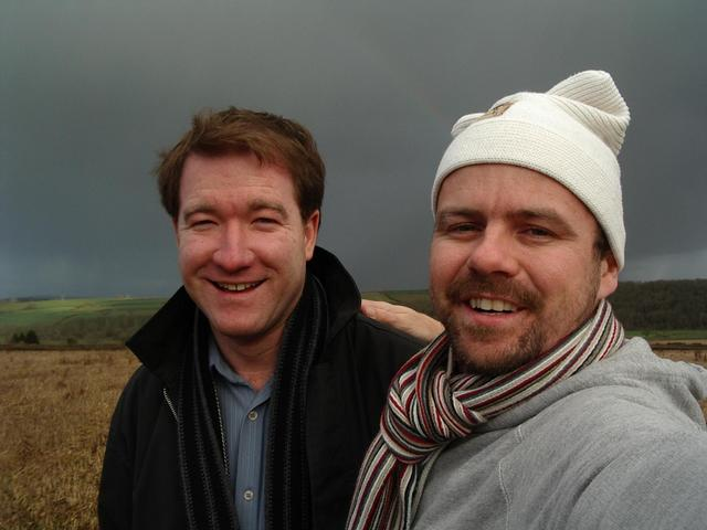Clayton and me at the spot with grey sky and rainbow