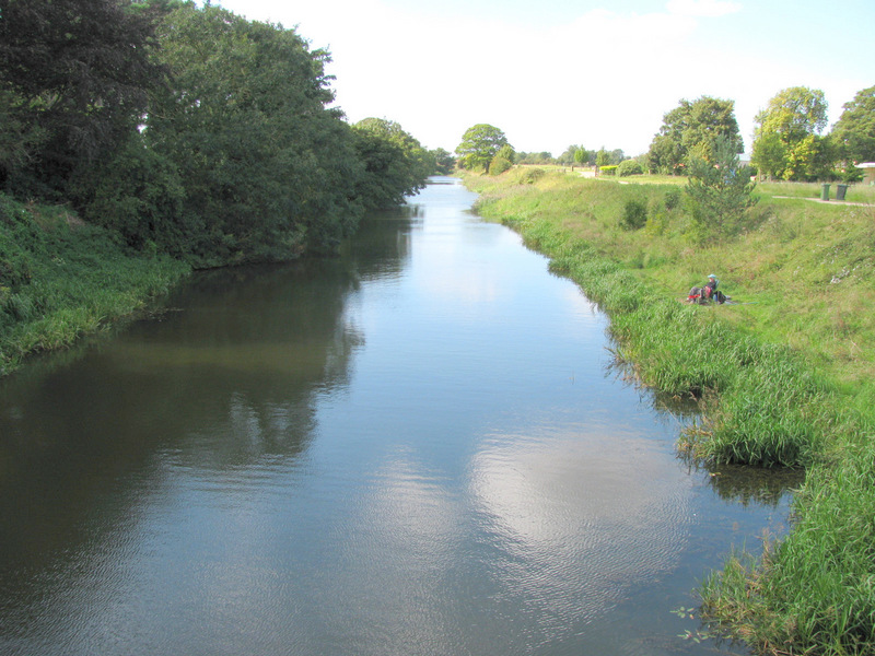 Cowbridge Drain and a fisherman seen West of Sibsey Road bridge.