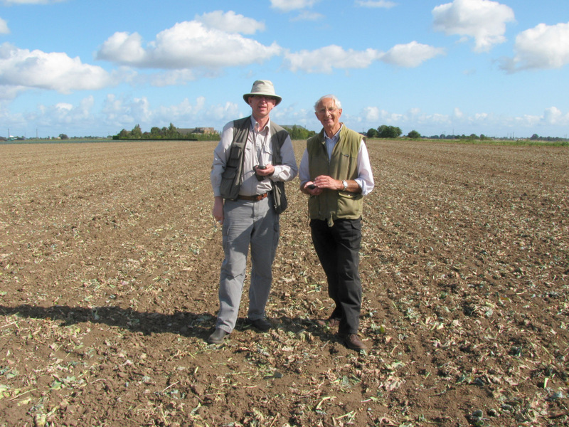 Alan and Gerald - two men out standing in their field.