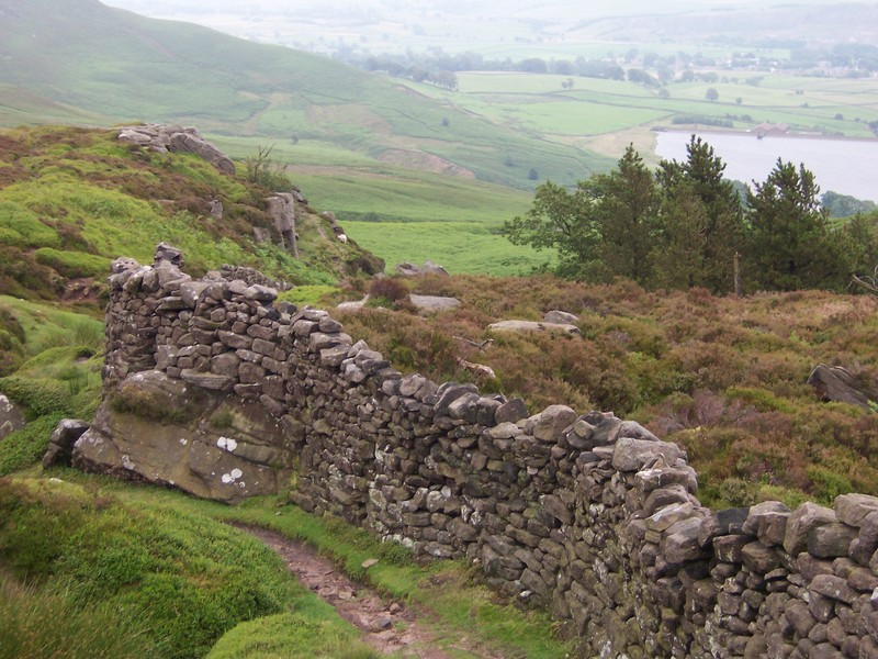 rock fence on moor, with reservoir in background