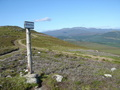 #9: Signpost to Mount Keen and brilliant blue sky.