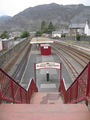 #11: Blaenau Ffestiniog railway station with both narrow guage and regular tracks.  Moelwyn Mountains in the background.