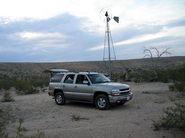 View northwest and shows our vehicle at the windmill near Grapevine Wash
