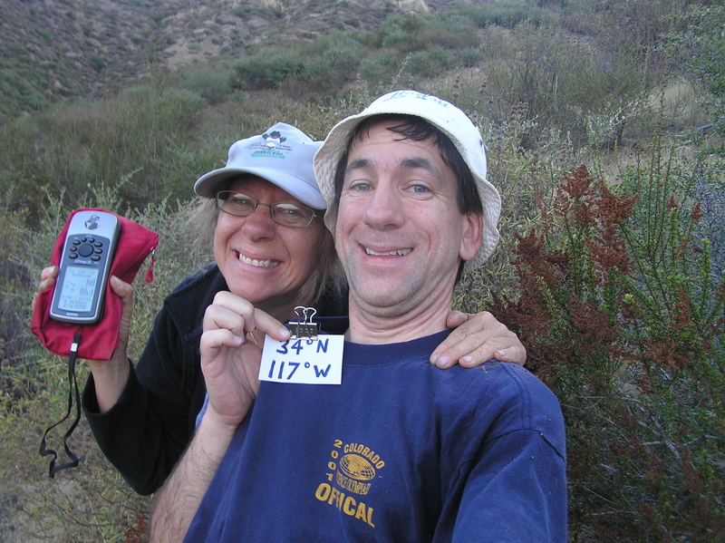 Cathy Lemarr and Joseph Kerski celebrate Centered Bliss at the confluence point.