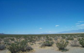 #1: Looking north, across the dry lake on the right you can partially make out the town of Pahrump