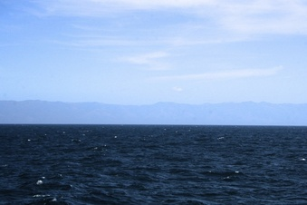 #1: Looking east towards Lopez Point.  The confluence is 21 NM @ 266 degrees true from Lopez Point.   The highest mountain on the horizon, is Cone Peak, at 5,155 ft.