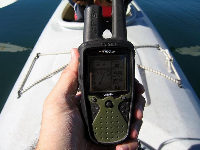 RINO GPS information. This picture shows me drifting 82 feet beyond the point. Notice how still and mirror-like the water is and the white film all over my hand. Since my RINO is waterproof, I was able to pour some fresh water over it to clean it before t