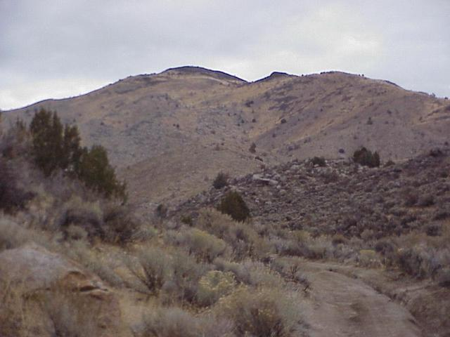 Route to the confluence site, looking northeast, confluence is to the right of the highest peak in the distance.