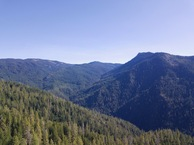 #9: View East (towards Lilly Mountain, elevation 5860 feet, less than a mile away), from 120m above the point