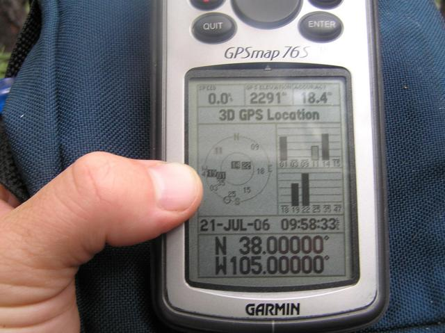 GPS reading at the confluence site--a sight I thought I would never see due to heavy tree cover and steep cliffs.