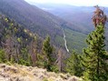#8: From atop the ridge 1.3 km west of the confluence, looking west on the starting point, the road.
