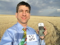#8: Out in the field with a map tie:  Joseph Kerski at the confluence of 41 North 103 West.