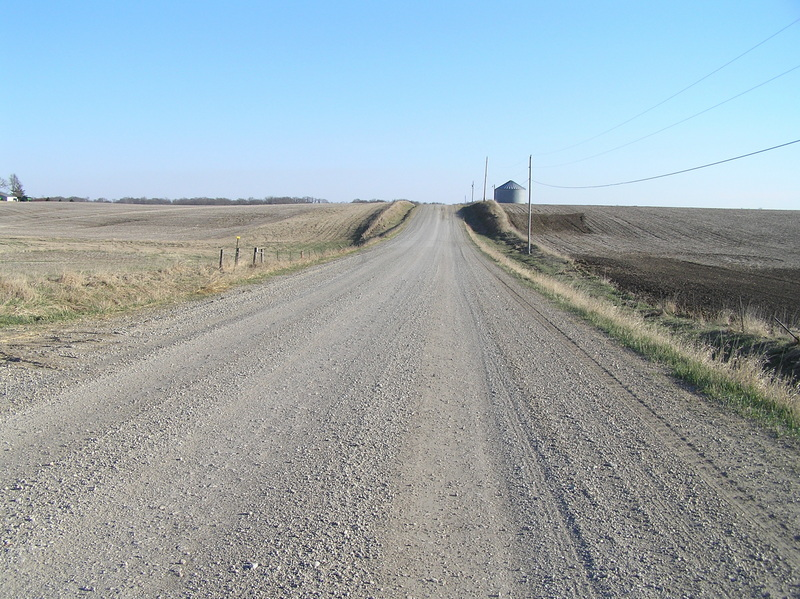 View due south 6 meters east of the 93rd Meridian, down the nearest roadway to the confluence.