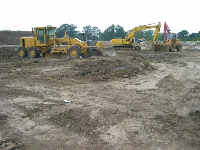 The field of earth-moving equipment to the East