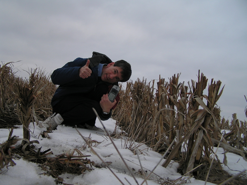 Joseph Kerski at the confluence point in the corn stalks.