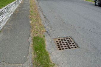 #1: The confluence point lies on this suburban road, close to this storm drain