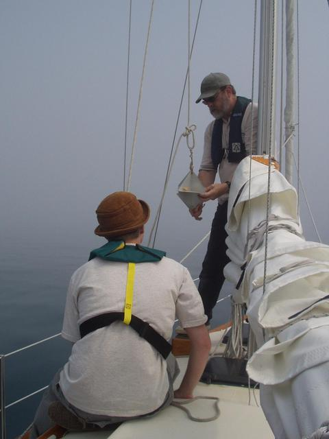 The captain, Steve Culver, raises the radar reflector at the start of the journey