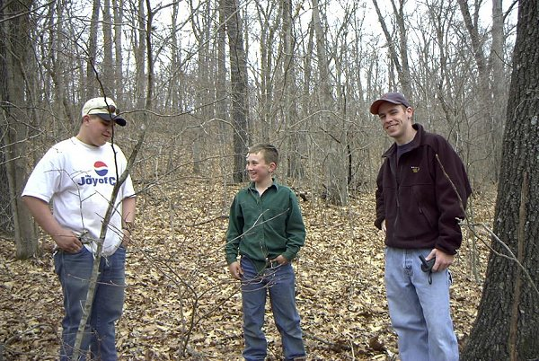 Two kids (our guides) and Jon at the confluence