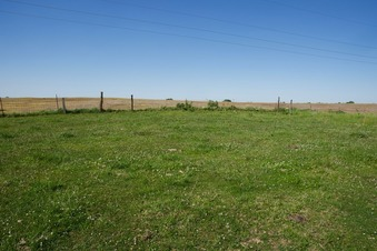 #1: The confluence point lies in this grassy farm field. (This is also a view to the North)