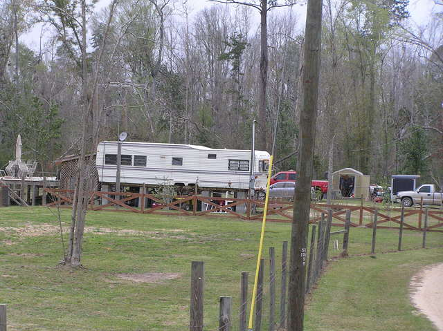 Innovative Mississippi housing:  Camper on stilts, with porch built off the back, 20 km southwest of confluence.