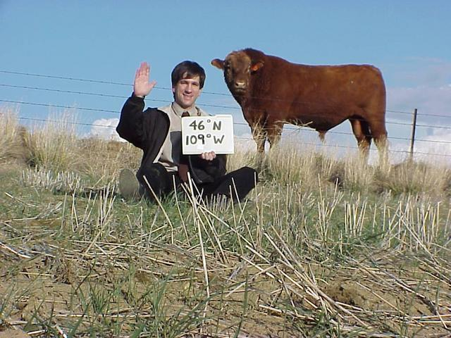 Joseph Kerski and unnamed cow pose at 46 North 109 West.