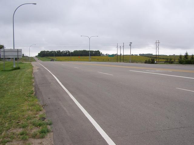 The view South along Highway 3 showing a field of sunflowers in the distance.