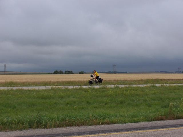 A lone cyclist pedaling towards the center of North America.