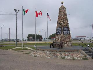 #1: Geographical Center of North America in Rugby, ND with the flags of Mexico, Canada and the USA.