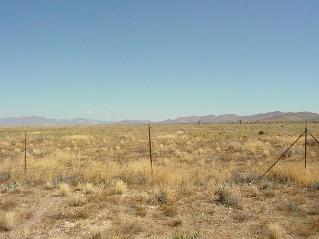 Small Concrete Structure on Other side of Fence is Plug Covering Hole where an Underground Nuclear Test was Conducted