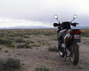 #1: Motorcycle sits on the confluence facing SSW towards the mountains surrounding Golfield, NV.