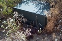 #7: A 'geocache' box (new in the past 10 years), next to the confluence point's famous rusted steel pipe