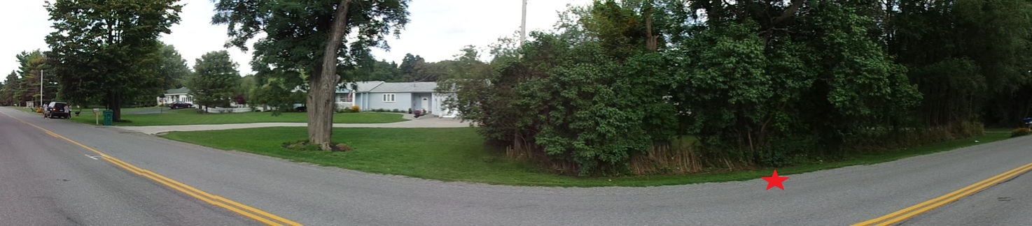 Panoramic view from the west side of the road. CP is marked by the red star.