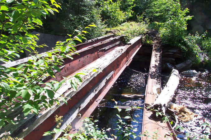 Destroyed bridge at the end of the road