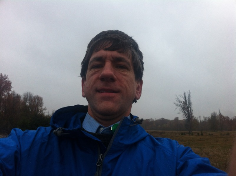 Joseph Kerski at the confluence point in the rain.