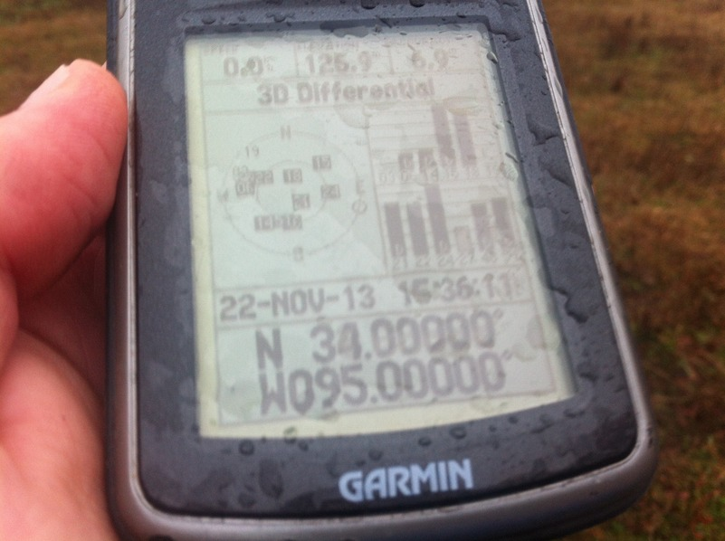 GPS receiver at confluence point.  I'm glad this unit is fairly waterproof.