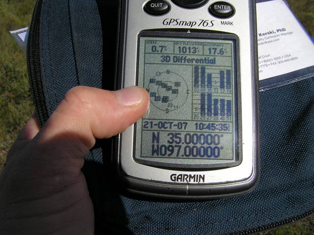 GPS reading at the confluence in the bright sunlight.