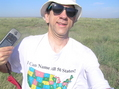 #8: Joseph Kerski at the 37 North 100 confluence point with geographic shirt.