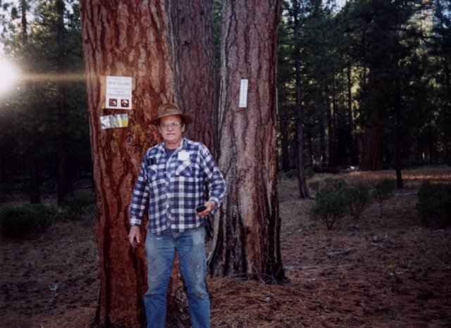 I am standing near the Crater Lake National Park boundary sign at N43 W122