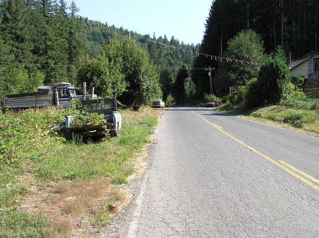 View South (along Myrtle Creek road).  More junked vehicles...