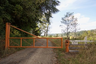 "#1: This gate - 0.27 miles from the point - was present during my last visit, 12 years ago, but it's now signed ""No Trespassing"""
