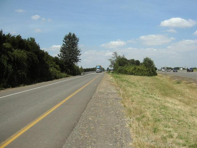 Confluence is to the left, directly in the path of that truck.  Looking  north.