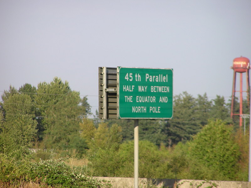 A close-up photo of the sign noting the 45th parallel