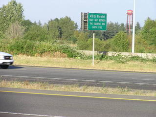 #1: The confluence point lies on this freeway on-ramp, in front of this car.  A sign notes the 45th parallel