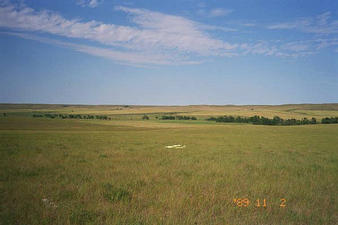 #1: Everything around this site looks a lot like this -- lots of grass and sky, few trees.