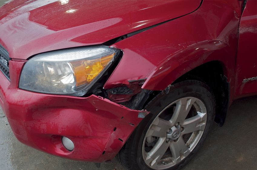 My car's smashed fender, after hitting a deer after leaving the confluence point.